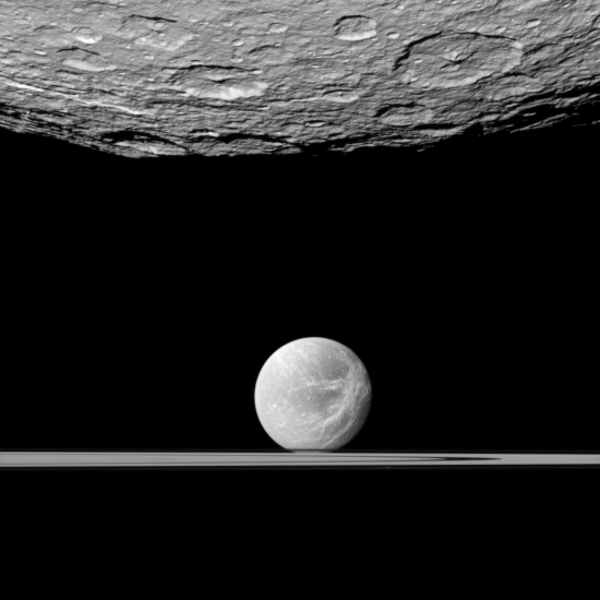 Looking past Rhea to Dione and Saturn's rings