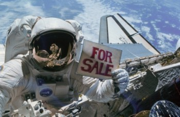 Dale Gardner spacewalking astronaut with for-sale sign