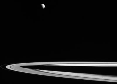 Titan over Saturn's rings