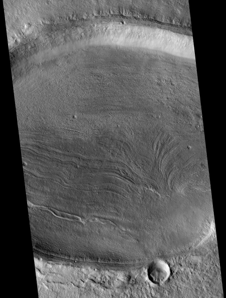 Elliptical crater with flow features