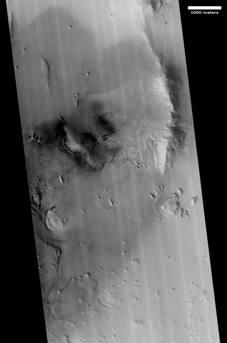 Dark splotches on slopes of Olympus Mons