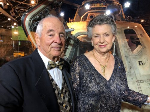 Bill and Valerie Anders, standing in front of the Apollo 8 capsule