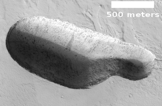 Sinkhole in Martian northern lowlands with dark seep