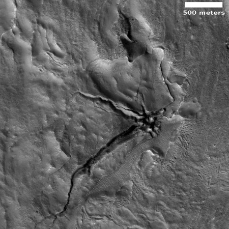Fractured collapse feature on Mars