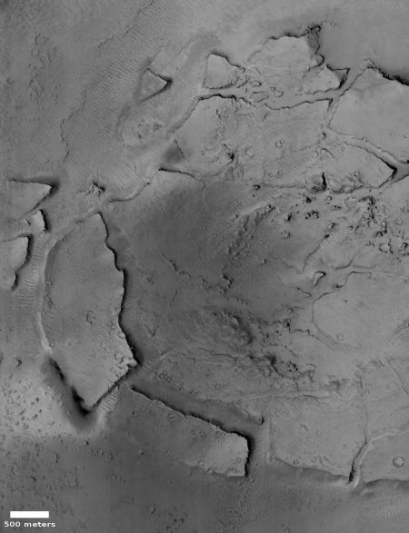 Fractured and collapse Martian crater floor