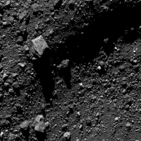 Truck-sized boulder on a crater rim on Bennu