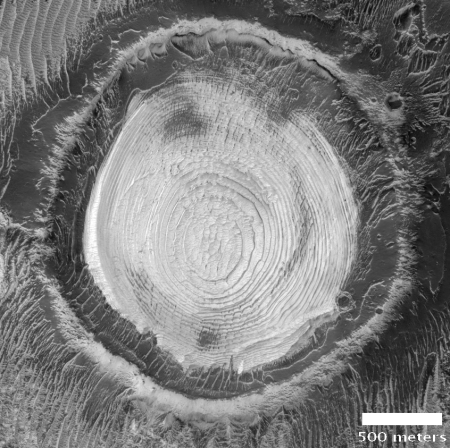 Layered crater at equator