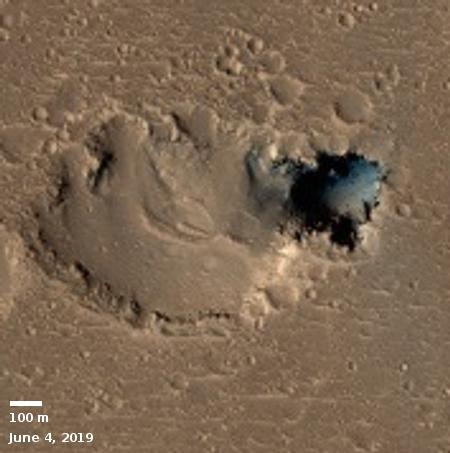 New close-up of Hephaestus Fossae pit