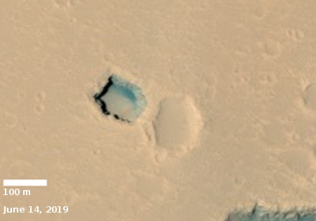 Second look at Hephaestus Fossae pit