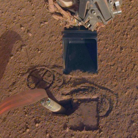 Mole in hole, with robot arm and scoop above