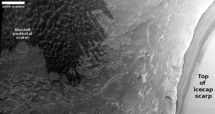 Buzzell pedestal crater in context with polar icecap scarp