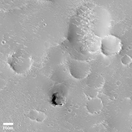 Pit near Hephaestus Fossae