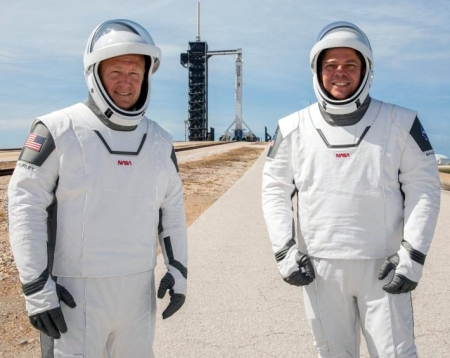 Douglas Hurley and Robert Behnken, with Falcon 9 in background
