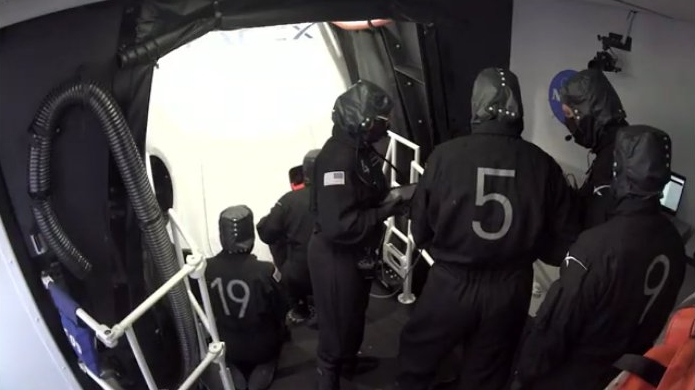 The ground crew doing the leak check after closing the hatch