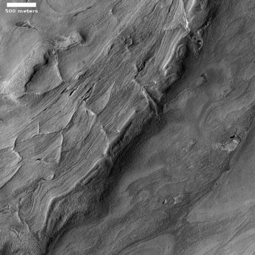 Squashed ridges at the basement of Mars