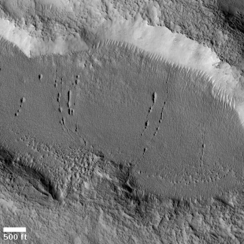 Glacial cracks or pits on Mars