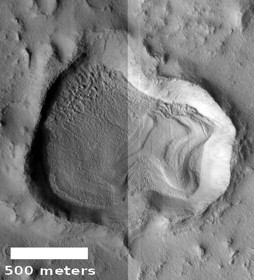 A very distorted and filled crater on Mars