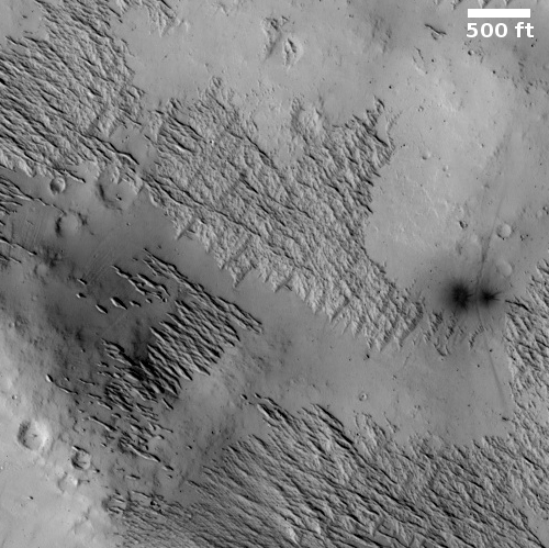Criss-crossing Martian ridges hit by new impacts