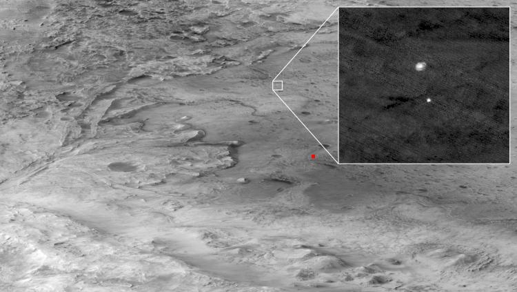 Oblique view showing Perseverance descending to Jezero Crater on parachute