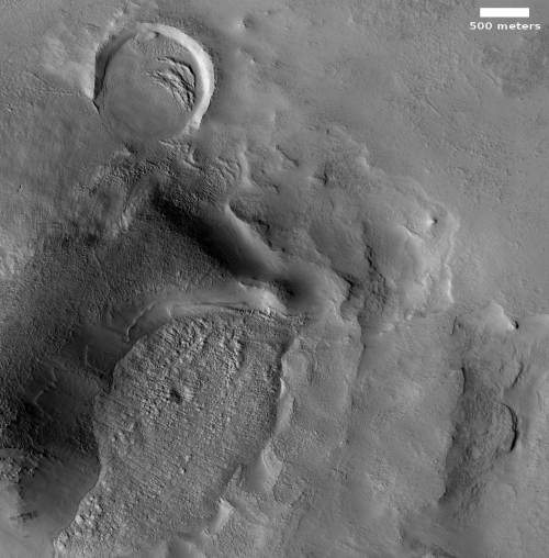 Partially covered crater by glacial flows?