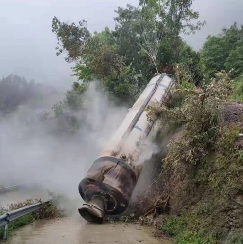 Long March 2F strap on booster after crashing onto public road