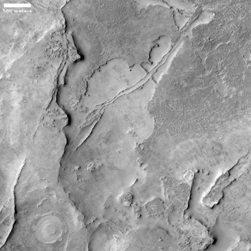 A dry bedrock crater floor?