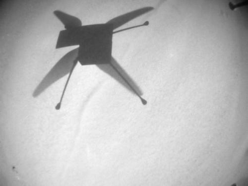 Ingenuity's shadow just before landing.