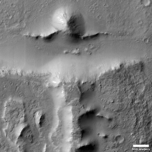 Broken mesas on Mars